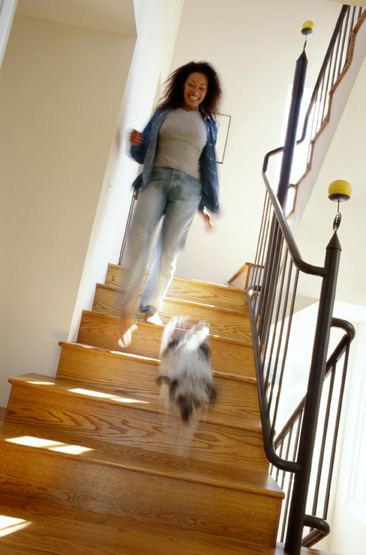 woman walking downstairs with dog